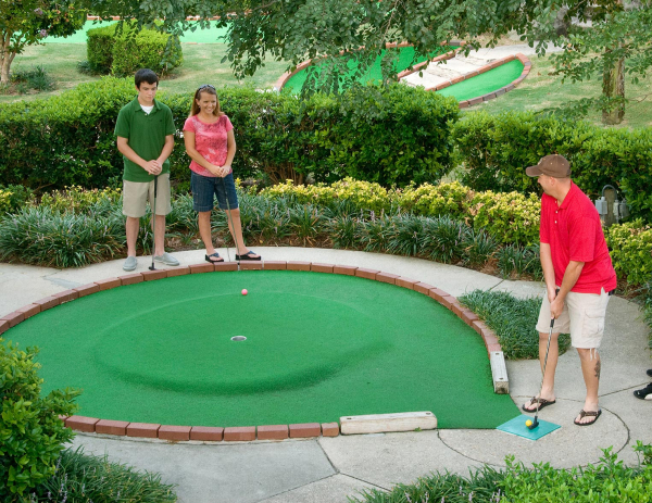 Small family playing mini golf at Coconut Creek!