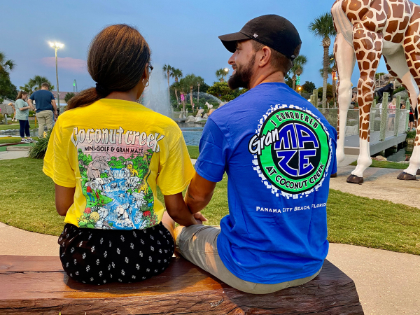 An image of a couple modeling some of our cool t-shirt designs in Panama City Beach, Florida.