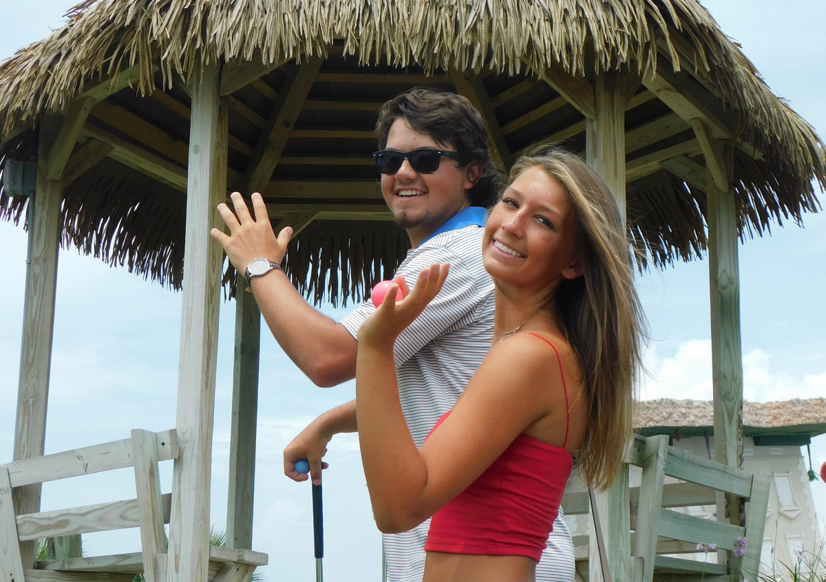 An image of a couple saying hi from Coconut Beach mini-golf in Panama City Beach, Florida!