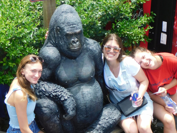 An image of 3 girls posing with our gorilla at Coconut Creek Family Fun Park in Panama City Beach, Florida.