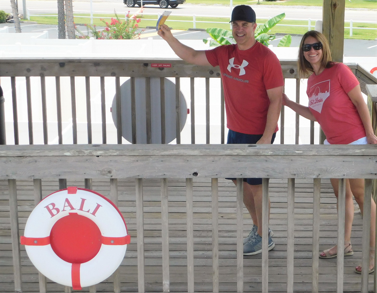 An image of a couple of people posing on the observation deck at Gran Maze in Panama City Beach, Florida.