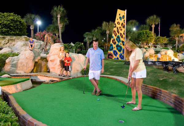 Family enjoying their time playing Mini-Golf at Coconut Creek
